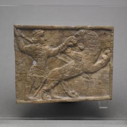 Plaque with a Hunter and Lion