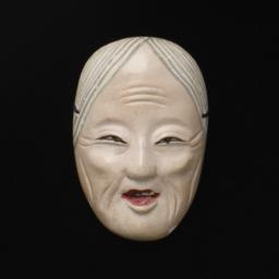 Small Mask Of Elderly Woman