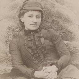 Mary Aitken Sitting Outdoors