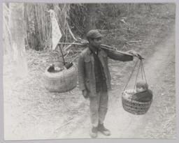 Man Carrying Children On Shoulder