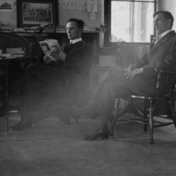 Two Men Sitting in a Office...