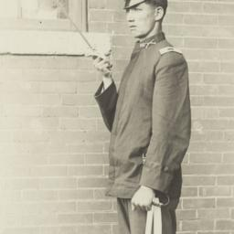 Young Man in Uniform Saluti...