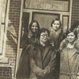 Five Women in Coats Posing ...