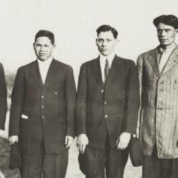 Four Men Standing in a Fiel...