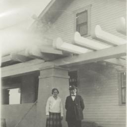Man and Woman Posing in fro...