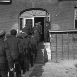 Group of Men Entering a Bui...