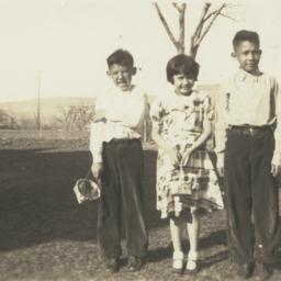Three Children Posing in Fi...