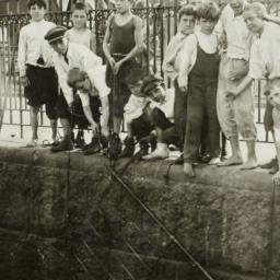 Boys Against Iron Fence