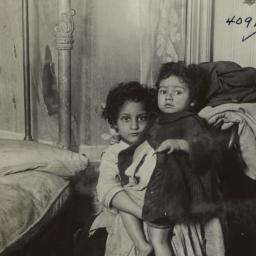 Two Children Beside Bed
