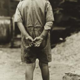 Boy With Hands Behind his Back