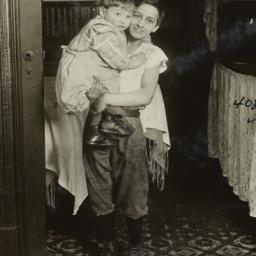 Boy Holding a Small Child