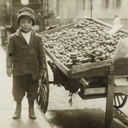 Boy near Fruit Stand