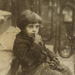 Child Sitting on Stoop