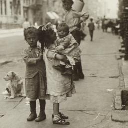 Children and Dog on Sidewalk