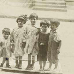 Children Standing on Frame