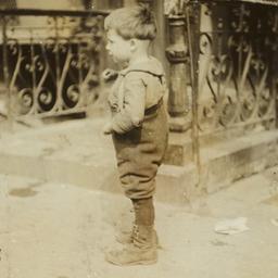 Boy Standing near Wrought I...