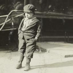 Boy in Front of Bread Shop