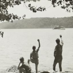 Boys Waving at Boat from Shore