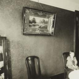 Woman with Boy in Dining Room
