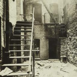 Airshaft with Boy on Stairs