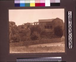 Rear facade, view from the canyon behind the house.
