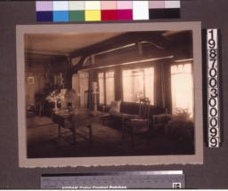 Living room\, view with library table and Tiffany lamp.