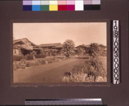 View from garden of outbuildings and rear elevation of main residence.