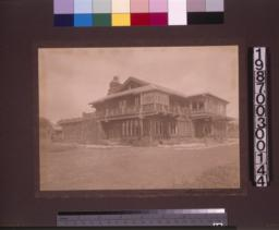 View of south (front) and west elevations.