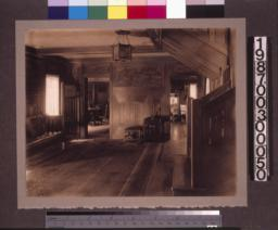 Entry hall, view past the staircase toward den (on right) and dining room.